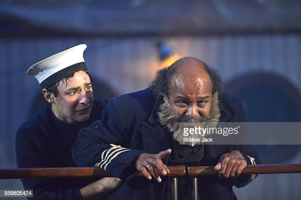 Vijayan Panikkaveettil as the captain with an artists of the company in Theatre du Soleil's production of Les Naufrages du Fol Espoir directed by...