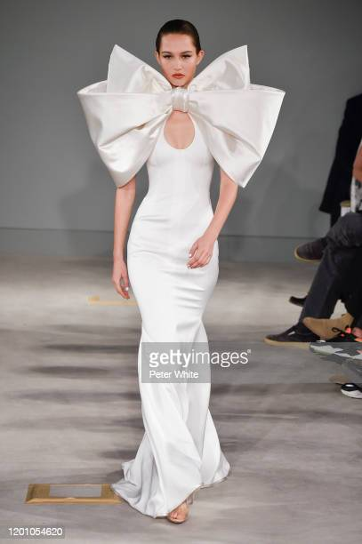 Vika Evseeva walks the runway during the Alexis Mabille Haute Couture Spring/Summer 2020 show as part of Paris Fashion Week on January 21 2020 in...