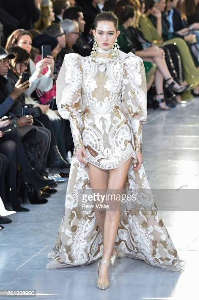 Vika Evseeva walks the runway during the Elie Saab Haute Couture Spring/Summer 2020 show as part of Paris Fashion Week on January 22, 2020 in Paris,...