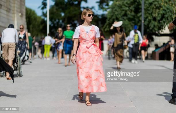 Vika Gazinskaya wearing a salmon coloured dress outside Viktor Rolf during Paris Fashion Week Haute Couture Fall/Winter 20172018 Day Four on July 5...