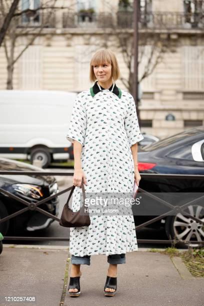 Vika Gazinskaya wearing Miu Miu shirt dress, jeans and black mules outside the Miu Miu show during Paris Fashion Week Womenswear Fall/Winter...