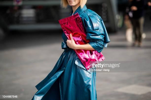 Vika Gazinskaya wearing pink clutch belted trench coat is seen outside Giambattista Valli during Paris Fashion Week Womenswear Spring/Summer 2019 on...