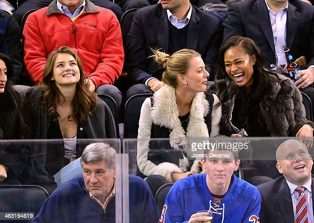 Vika Levina guest and Dani Evans attend the Detroit Red Wings vs New York Rangers game at Madison Square Garden on January 16 2014 in New York City