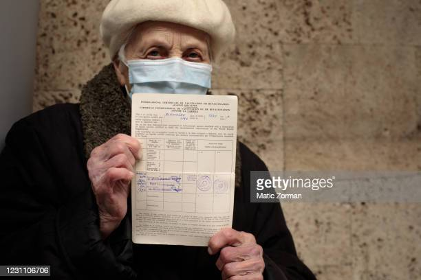 Vika Planinsek displays her vaccination certificate in the vaccination centre on February 11, 2021 in Kranj, Slovenia. Slovenia plans to vaccinate 5%...