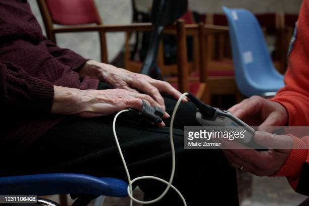 Vika Planinsek gets her blood pressure measured after receiving an injection of Moderna vaccination in the vaccination centre on February 11, 2021 in...