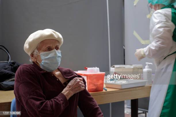 Vika Planinsek receives an injection of Moderna vaccination in the vaccination centre on February 11, 2021 in Kranj, Slovenia. Slovenia plans to...