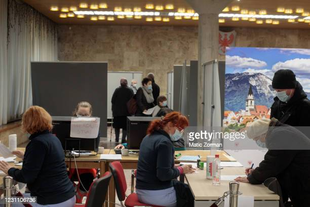 Vika Planinsek registers at the reception desk of the vaccination centre, before receiving a vaccination on February 11, 2021 in Kranj, Slovenia....