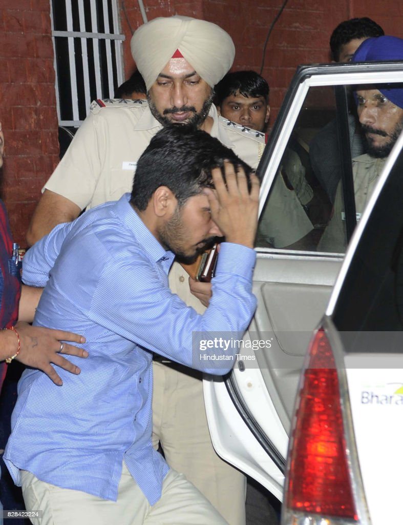 Vikas Barala being taken into Chandigarh police custody at Sector 26 Police Station on August 9 2017 in Chandigarh India Varnika Kundu the daughter...