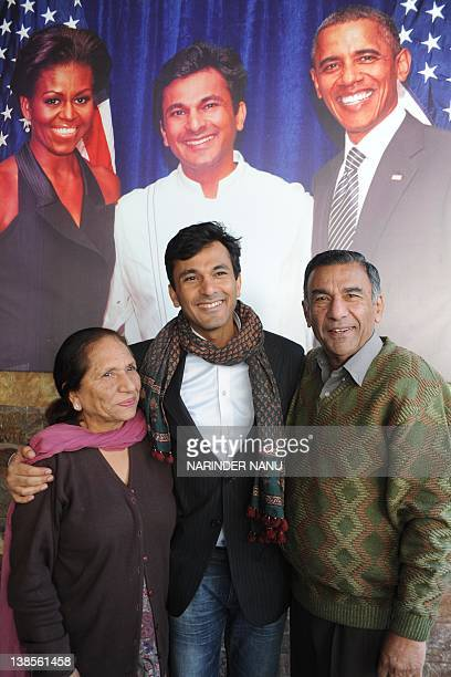 Vikas Khanna master chef India host and executive chef of Junoon restaurant in New York and his mother Bindu khanna and father Davinder Khanna poses...