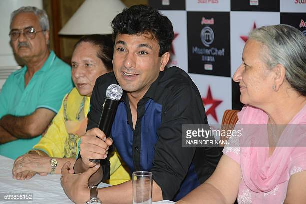 Vikas Khanna MasterChef India host and executive chef of Junoon restaurant in New York addresses the media during a promotional event for the...