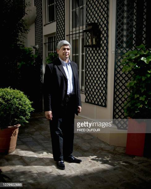 """Vikas Swarup, Indian diplomat and author of the first novel """"Q&A"""", successfully adapted for the screen as """"Slumdog Millionaire"""" poses on May 21, 2010..."""