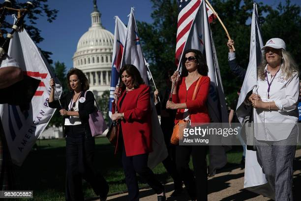 Viki Harrison executive director of Common Cause New Mexico participates in a march to Senate Hart Office Building June 25 2018 on Capitol Hill in...