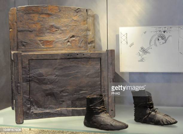 Viking age. Leather shoes of a woman. At background, beechwood chair. Viking Ship Museum. Oslo. Norway.