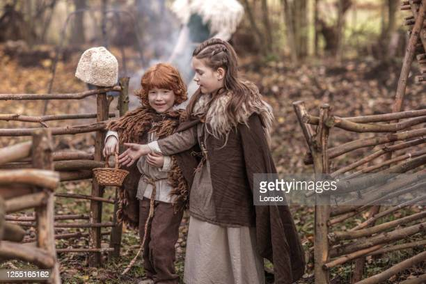 viking children in a viking village settlement - historical clothing stock pictures, royalty-free photos & images