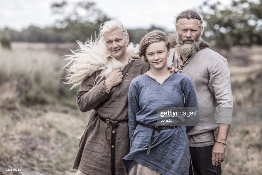 A viking family in a viking village settlement : Stock Photo
