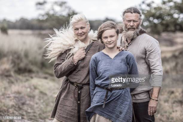 a viking family in a viking village settlement - danish culture stock pictures, royalty-free photos & images