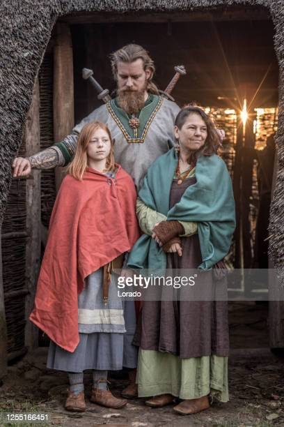 a viking family in a viking village settlement - historical clothing stock pictures, royalty-free photos & images