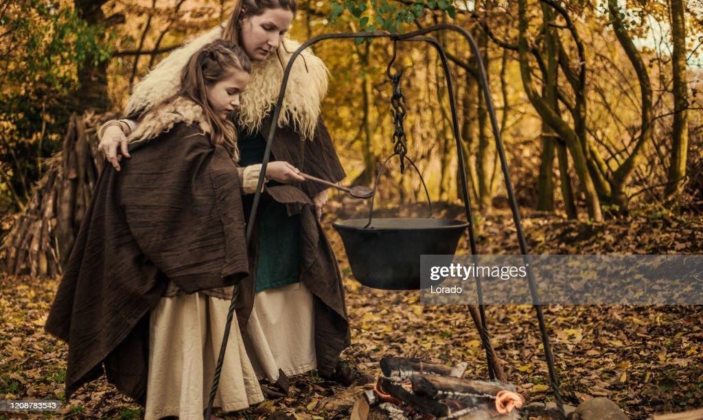 A viking family scene in a viking village settlement : Stock Photo