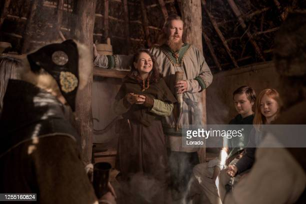 a viking family scene in a viking village settlement - scandinavian ethnicity stock pictures, royalty-free photos & images