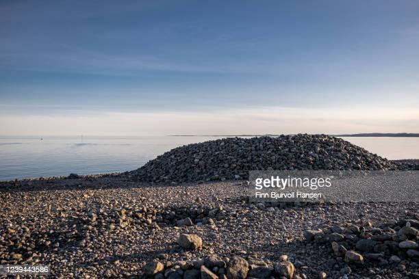 viking grave at molen in vestfold norway. stone beach and the ocean in background - finn bjurvoll stock pictures, royalty-free photos & images