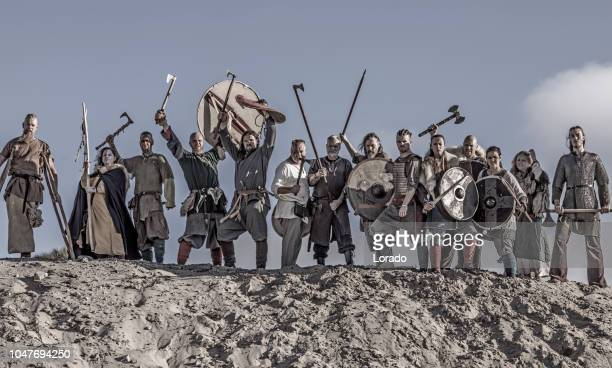 viking group - barbarian stock photos and pictures