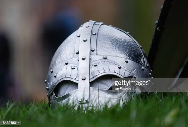 Viking helmet lies on the grass as re-enactors from Canute's Army prepare march to Coppergate in a show of strength before battle during a living...