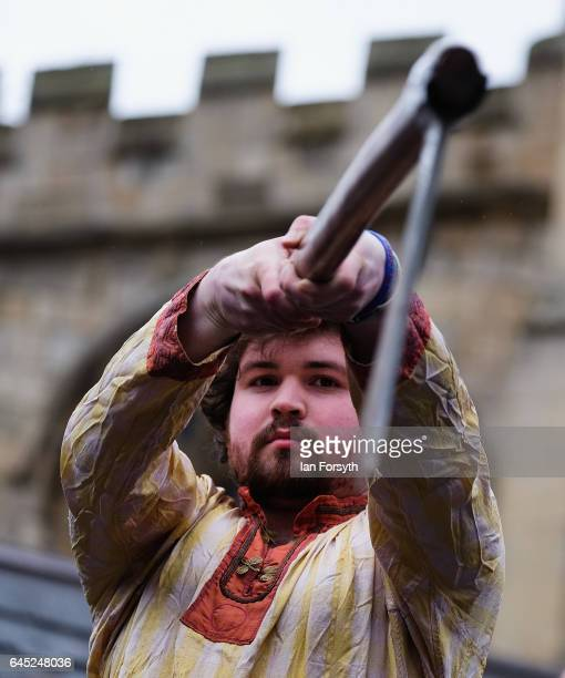 Viking holds up an axe as he takes part in a strength competition during a living history display on February 25, 2017 in York, United Kingdom. The...