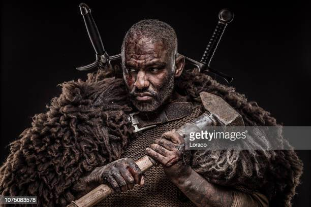 viking inspired black warrior - barbarian stock photos and pictures