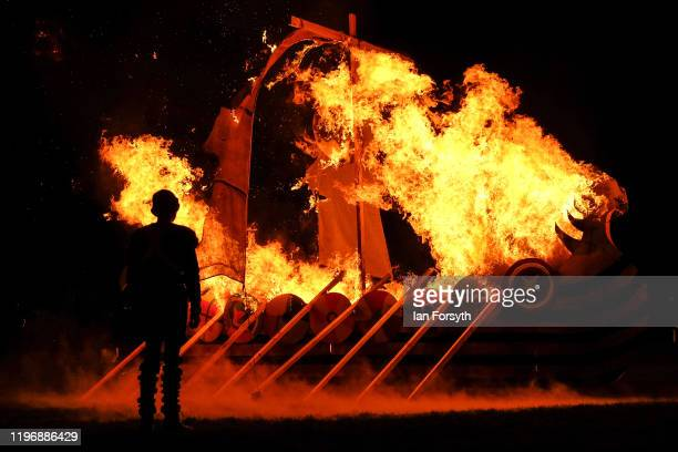 Viking long ship is burned during New Year's Eve celebrations at the Flamborough Fire Festival on December 31 2019 in Flamborough England Now in its...