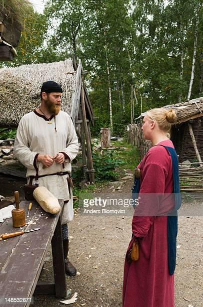 Viking man and woman at World Heritage site of Birka on Bjorko Island.
