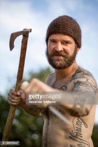 Viking Man Attacking With Axe And Knife High Res Stock
