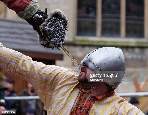 Viking meets an opponent in one on one combat as they take part in a strength competition during a living history display on February 25, 2017 in...