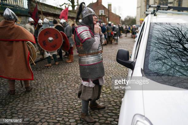Viking reenactor adjusts his helmet before he joins the march through York during a living history display as part of the 36th York Viking Festival...
