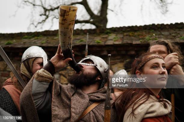Viking reenactor blows a horn as he prepares to march through York during the 36th York Viking Festival on February 22 2020 in York England The march...