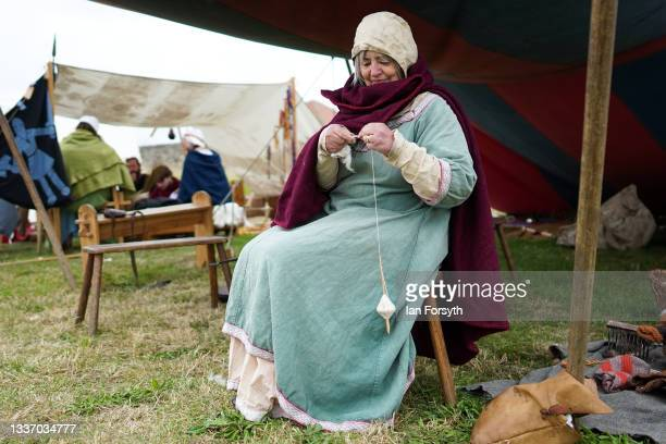 Viking re-enactor demonstrates weaving in the grounds of Whitby Abbey on August 29, 2021 in Whitby, England. Around 130 re-enactors gather at Whitby...