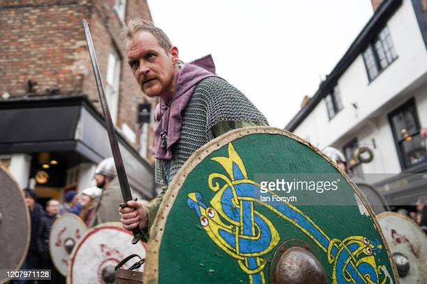 Viking reenactor gestures to the crowd as he marches through York as part of the 36th York Viking Festival on February 22 2020 in York England The...