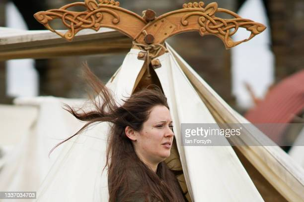 Viking re-enactor looks out from her tent in the grounds of Whitby Abbey on August 29, 2021 in Whitby, England. Around 130 re-enactors gather at...