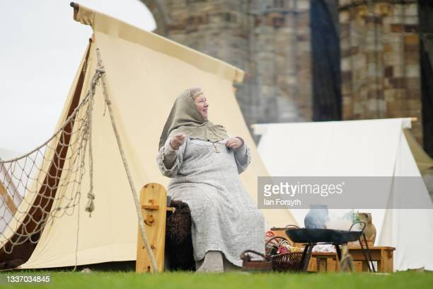 Viking re-enactor prepares breakfast as she sits outside her tent in the grounds of Whitby Abbey on August 29, 2021 in Whitby, England. Around 130...