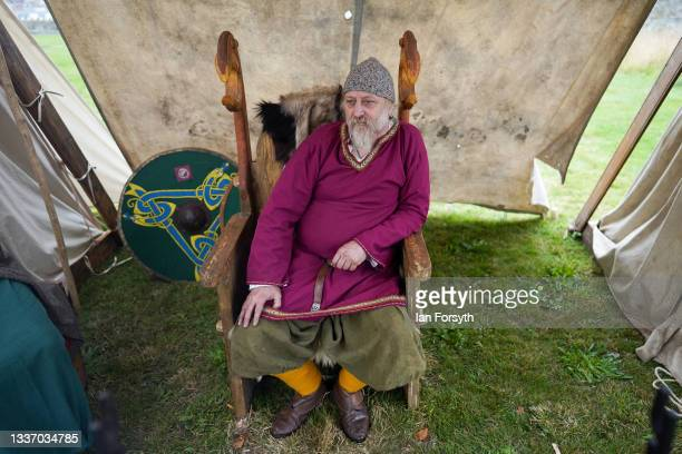Viking re-enactor sits in his chair outside his tent in the grounds of Whitby Abbey on August 29, 2021 in Whitby, England. Around 130 re-enactors...