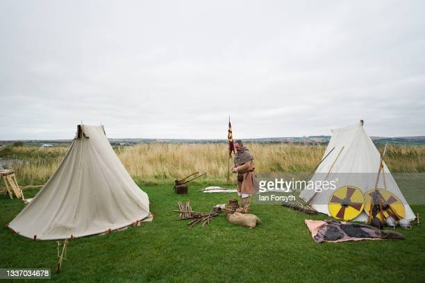Viking re-enactor stands between tents in the grounds of Whitby Abbey on August 29, 2021 in Whitby, England. Around 130 re-enactors gather at Whitby...