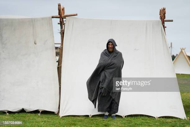 Viking re-enactor stands next to tents in the grounds of Whitby Abbey on August 29, 2021 in Whitby, England. Around 130 re-enactors gather at Whitby...