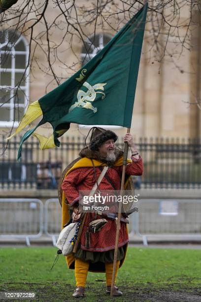 Viking reenactor stands with a flag during the 36th York Viking Festival on February 22 2020 in York England The march was the culmination of a week...