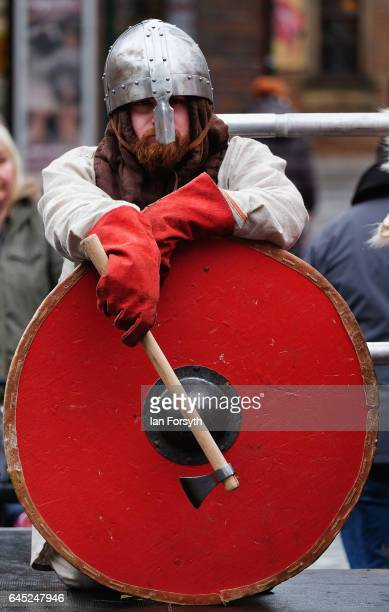 Viking re-enactor waits to compete in one on one combat with an opponent during a living history display before a march and battle on February 25,...