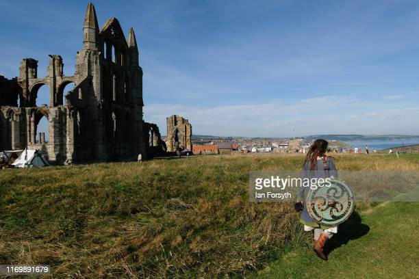 Viking reenactor walks past the Abbey ruins during the Viking Festival at Whitby Abbey on August 24 2019 in Whitby England Temperatures are expected...