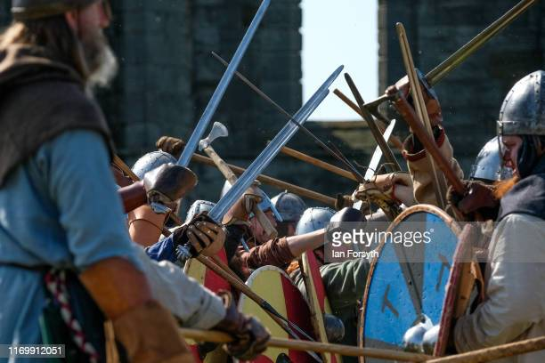 Viking reenactor warrior skirmish with the Northumbrian's during the Viking Festival at Whitby Abbey on August 24 2019 in Whitby England Temperatures...