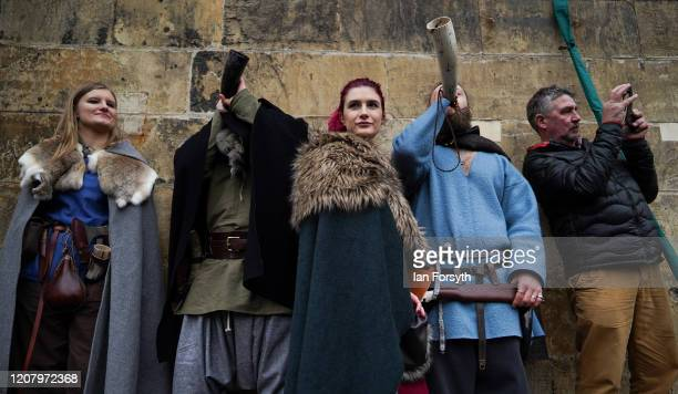 Viking reenactors blow horns as other Vikings march through York during the 36th York Viking Festival on February 22 2020 in York England The march...