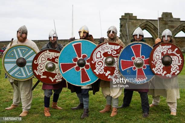 Viking re-enactors form a shield wall as they demonstrate fighting techniques in the grounds of Whitby Abbey on August 29, 2021 in Whitby, England....