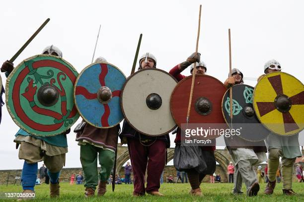 Viking re-enactors form a shield wall as they skirmish in the grounds of Whitby Abbey on August 29, 2021 in Whitby, England. Around 130 re-enactors...