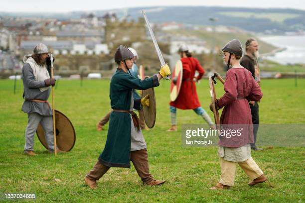 Viking re-enactors practice their fighting techniques before a demonstration in the grounds of Whitby Abbey on August 29, 2021 in Whitby, England....