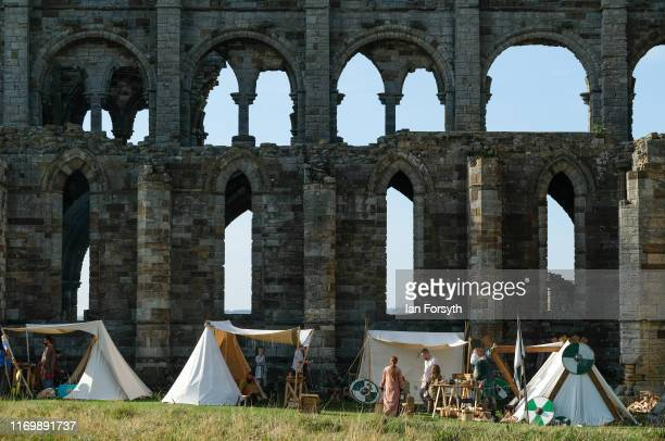 Viking reenactors set up camp during the Viking Festival at Whitby Abbey on August 24 2019 in Whitby England Temperatures are expected to climb over...